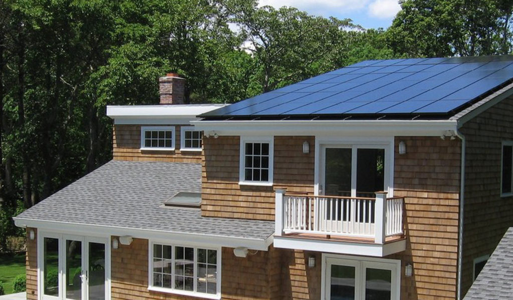 Photo of house with solar panels