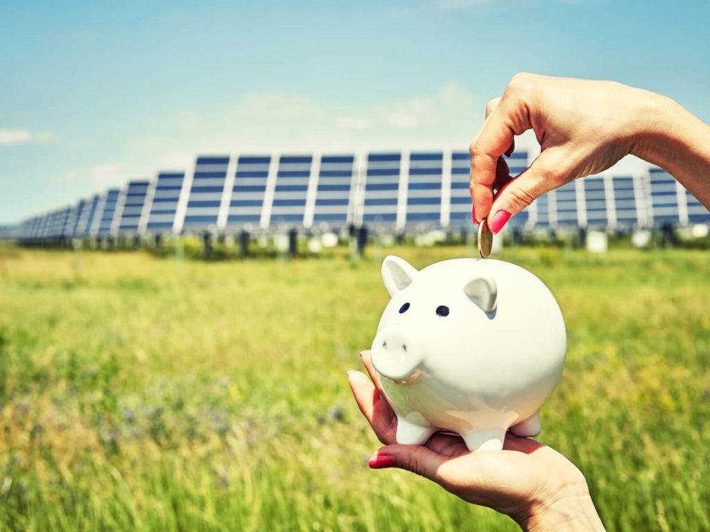woman putting money into piggybank due to free solar panels