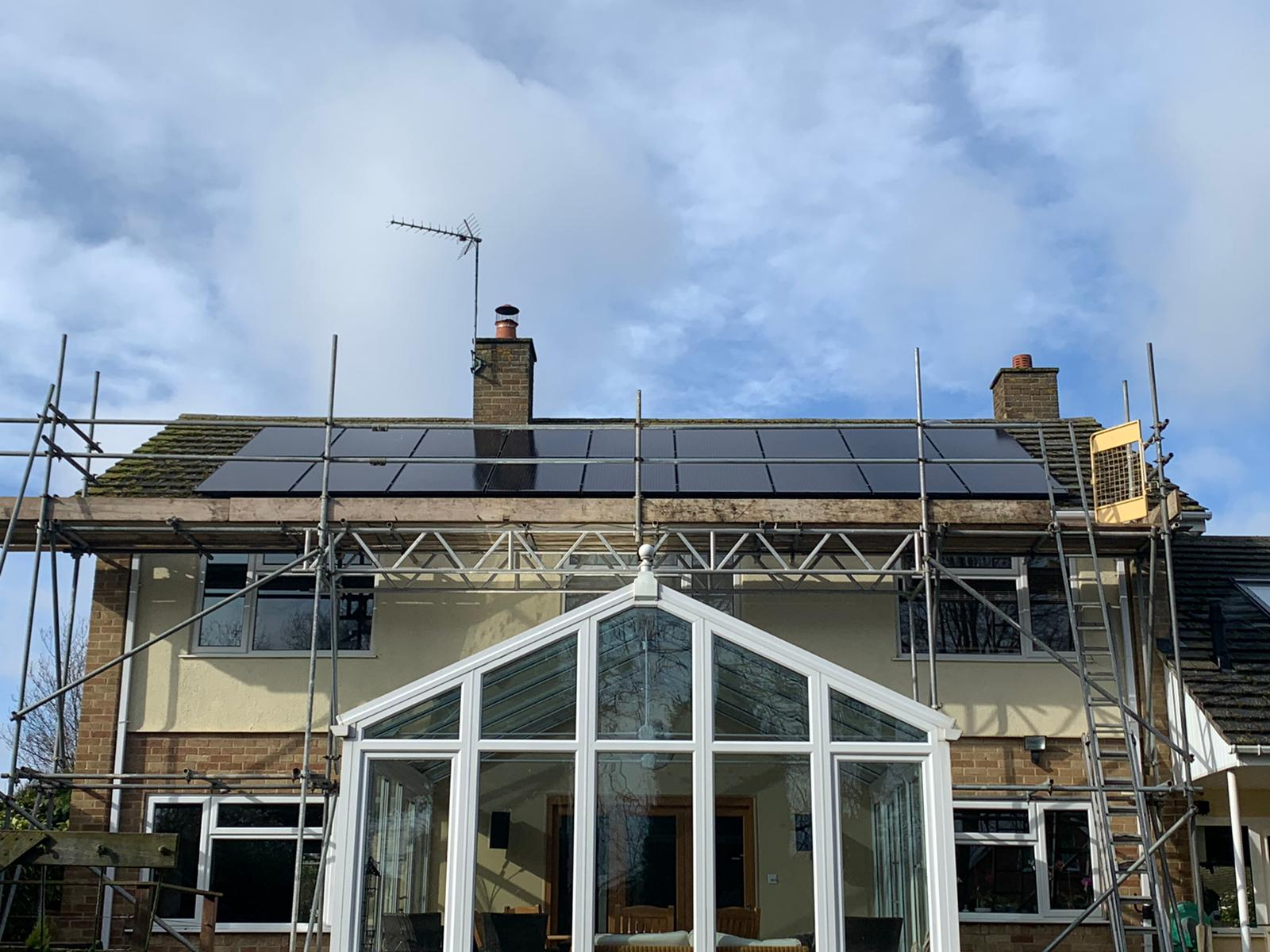 solar panel installation on roof with scaffolding